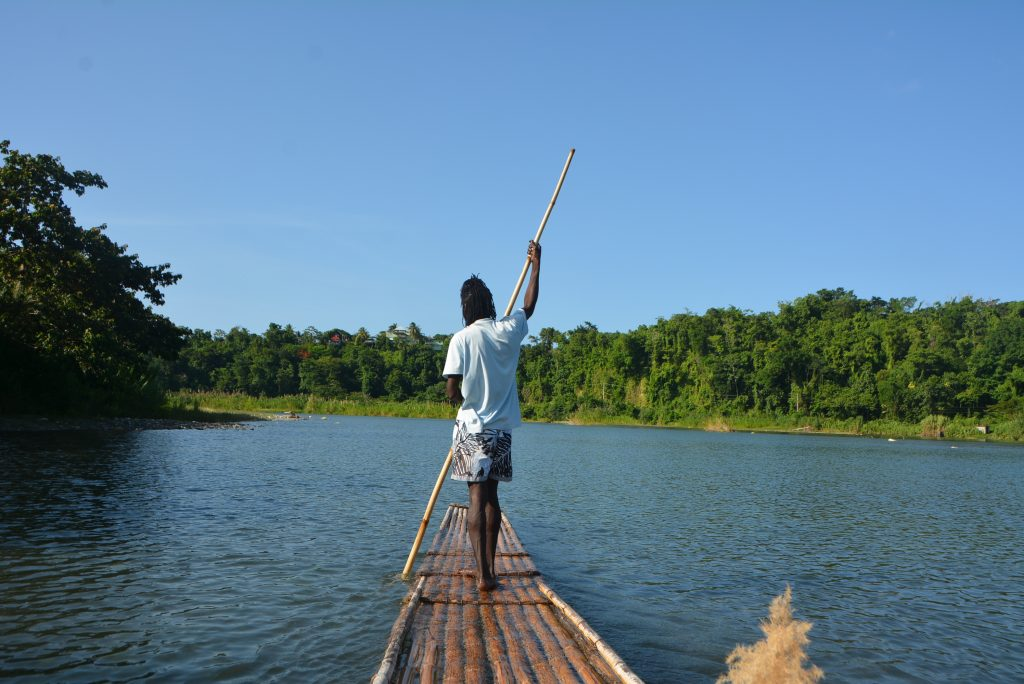 #VisitJamaica: Bamboo raftsman Curtis guiding his raft along the Rio Grande River