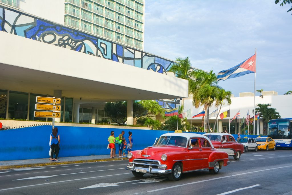 Traffic on the street outside La Habana Libre Hotel in Havana, Cuba.