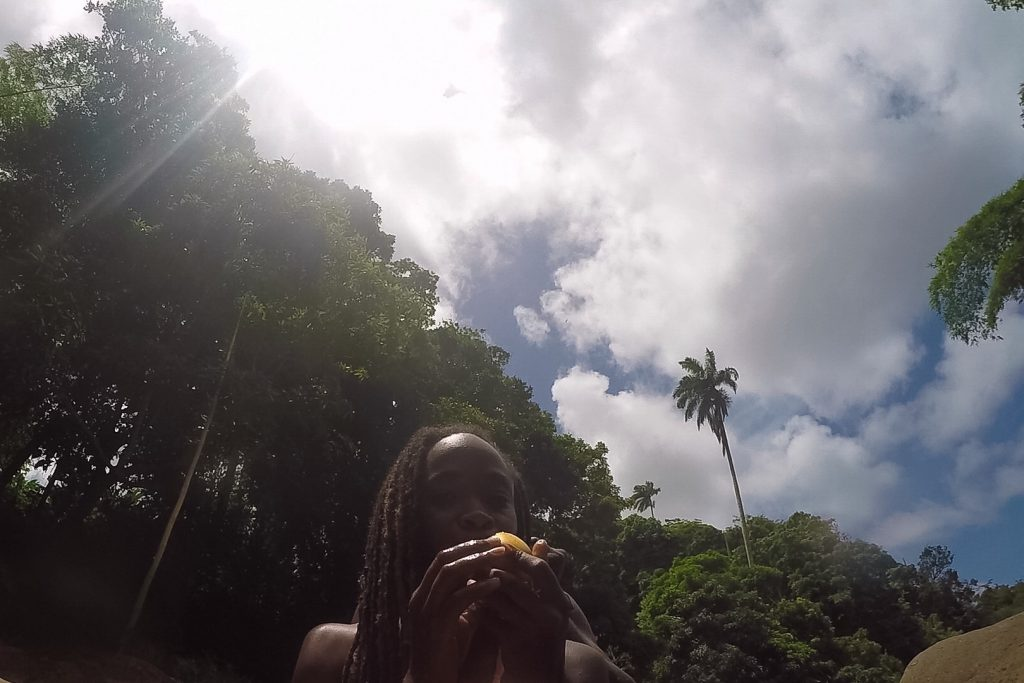 #PureGrenada: Enjoying a juicy mango after tubing.